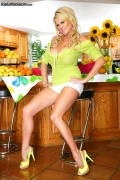 Kelly Madison plays with cucumber from Kelly Madison