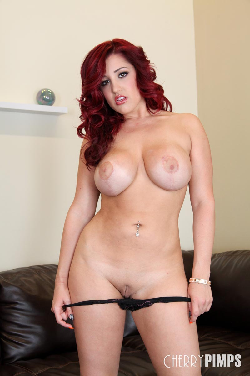 a busty redhead with toy from andy